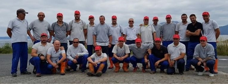 After a long day collecting plastic and waste around the natural reserve of Miñarzos, Stolt Sea Farms' Lira team take a break to pose for a group photo.